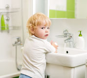 Kid washing hands with soap Royalty Free Stock Photos