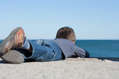 Kid watching the horizon. Royalty Free Stock Photography