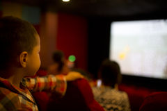 Kid watching movie Royalty Free Stock Photography