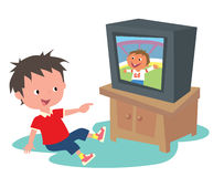 Kid watching TV. A boy smiling happily seeing himself show up on TV Stock Image