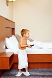 Kid watching tv in hotel room after bathing Royalty Free Stock Photos