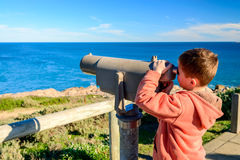 Kid watching whales Stock Images