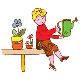 Kid watering flowers at home Stock Image