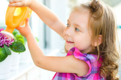Kid watering flowers Royalty Free Stock Photography