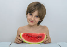 Kid with watermelon Stock Images