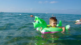 Kid in the waves stock footage