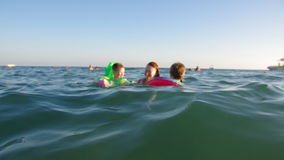 Kid in the waves on the sea stock footage