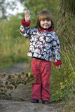Kid waving for goodbye. Standing alone before long way in the trees royalty free stock photography