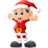 Kid waving wearing santa costume Stock Image