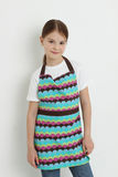 Kid wearing colorful apron Royalty Free Stock Images
