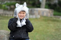 Kid Wearing Gray Wolf Critter Hat and Black Jacket Royalty Free Stock Photos