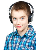 Kid wearing headphones Royalty Free Stock Image