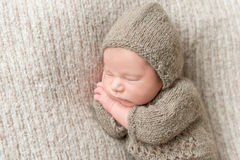 Kid wearing knitted brown costume, closeup Stock Photos