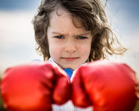 Kid wearing red boxing gloves Royalty Free Stock Photography