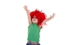Kid wearing a red feather wig Stock Photos