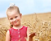 Kid in wheat field. Stock Photo