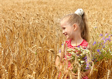 Kid in wheat field. Royalty Free Stock Photos