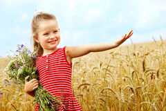 Kid in wheat field. Stock Image