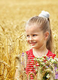Kid in wheat field. Royalty Free Stock Photo