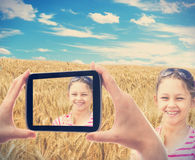 Kid in a wheat field Royalty Free Stock Images