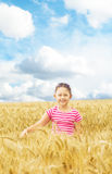 Kid and a wheat field Stock Photos