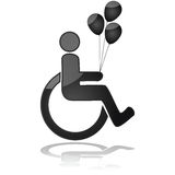 Kid in wheelchair holding balloons Stock Image