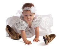 Kid in white dress crawling Stock Images
