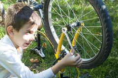 Kid who fix bikes Royalty Free Stock Image