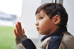 A kid on the window Stock Photography