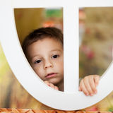 Kid in the window of the tree house Royalty Free Stock Photography