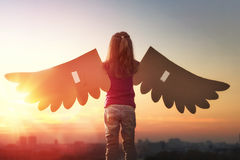 Kid with the wings of a bird Stock Photography