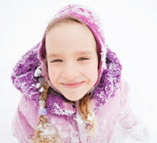 Kid in winter Stock Images