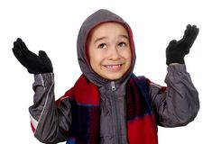 Kid in winter clothes, hands up royalty free stock images