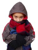Kid in winter clothes peeking through hood. Seven year old boy in winter clothes peeking through his hood, isolated on pure white background stock image