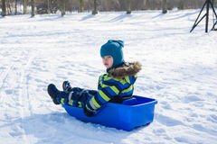 Kid in winter park Royalty Free Stock Images