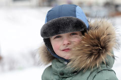 Kid in winter park Stock Image