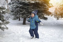 The kid in the winter on walk Stock Photo