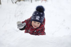The kid on winter walk Royalty Free Stock Photos