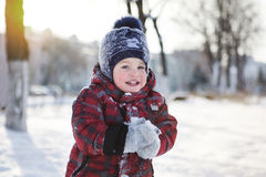 The kid on winter walk Royalty Free Stock Images