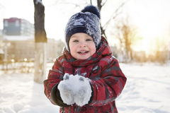 The kid on winter walk Stock Images