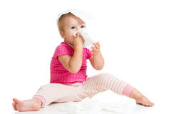 Kid wiping cleaning nose with tissue Royalty Free Stock Photos