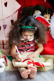 Kid wish list. Small girl writing a letter Royalty Free Stock Images