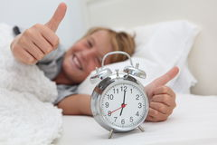 Kid With Alarm Clock Stock Images