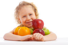 Kid With Apples And Oranges Stock Photography