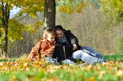 Kid and woman with notebook Stock Photography