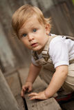 Kid on the wooden porch. Royalty Free Stock Images