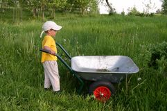 Kid in Work Stock Image