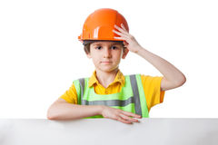 Kid in work clothes stands with billboard Stock Photo
