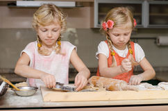 Kid working in kitchen Stock Images