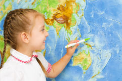 Kid by world map. Happy little girl smiles by world map royalty free stock photography